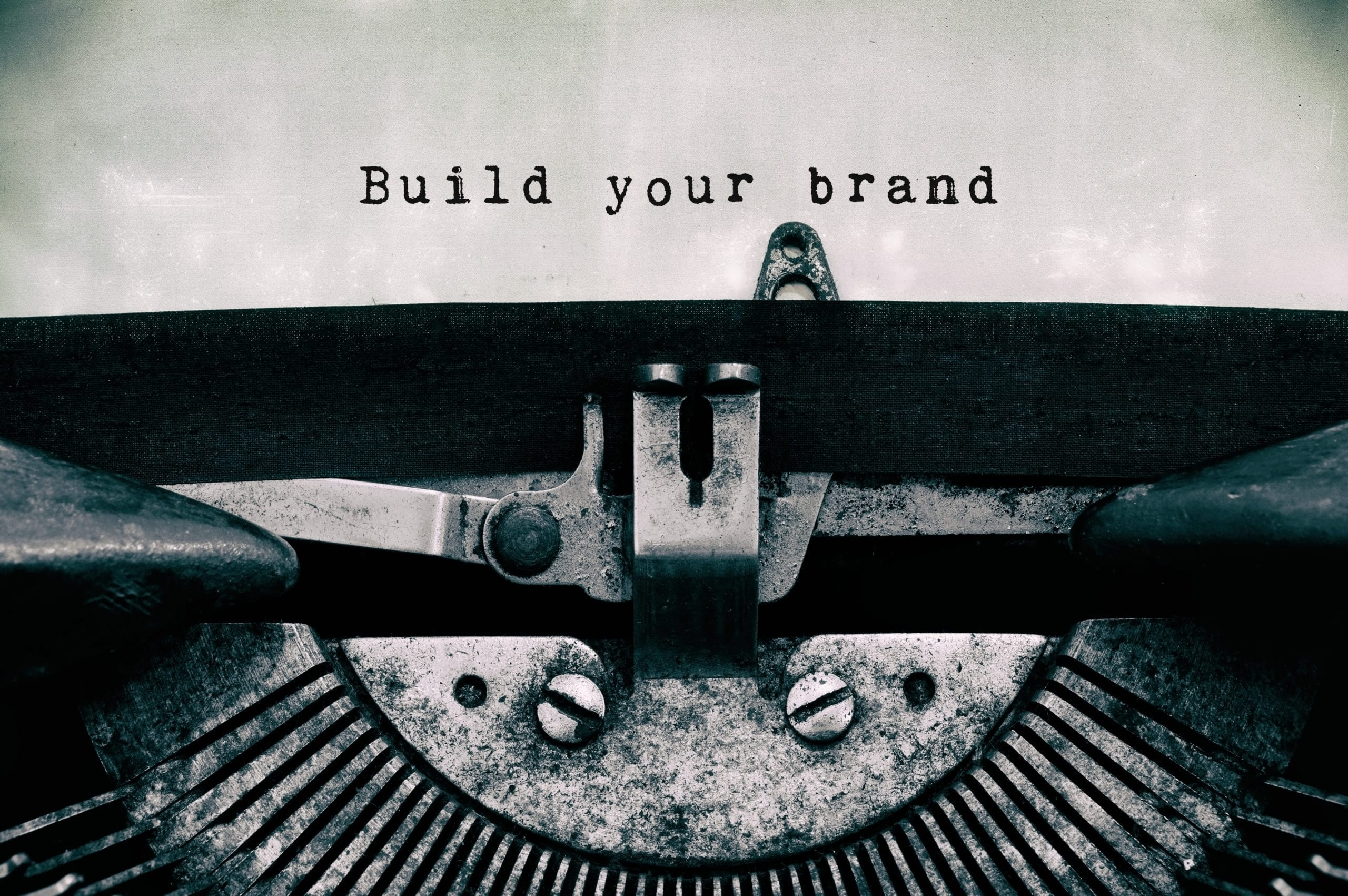 """An image of a type writer that has typed """"Build your brand."""""""